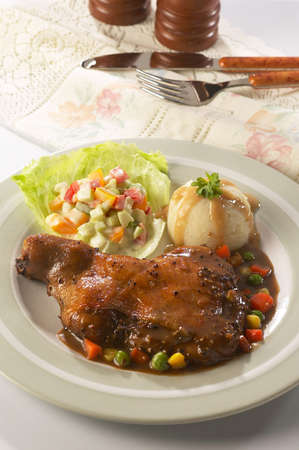 Juicy platter of chicken steak served with mashed potatoes and vegetable. photo