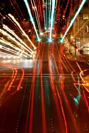 streaked: City lights and car lights streaked by zoom and motion. Stock Photo