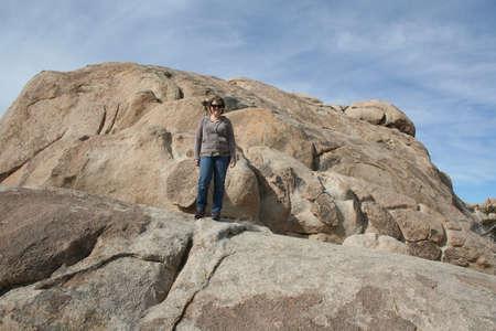 Woman on Rock in Joshua Tree National Park California USA Stock Photo