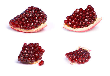 Four peaces of pomegranate seeds on white background photo
