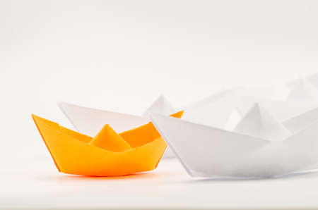 leadership concept. paper ships follow the leader origami ship