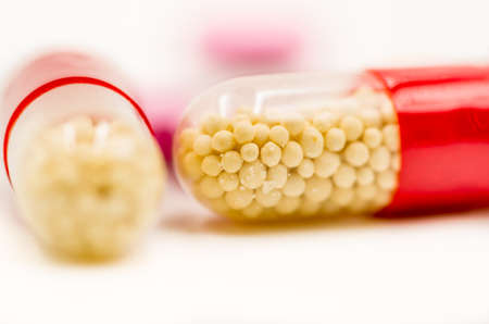 ampoule: colorful medicine pills on the white background Stock Photo
