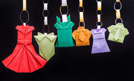 typical: prigamipaper clothes hanging on the black background Stock Photo