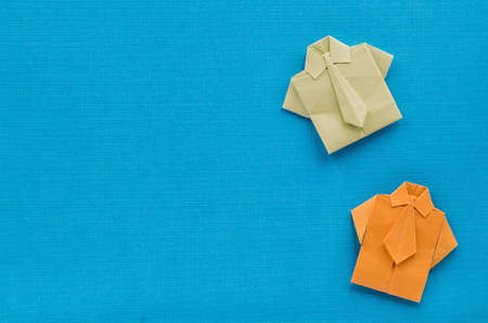 typical: origami paper businessman shirts with ties on textures blue background