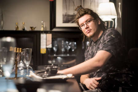 european man with afro hairstyle is choosing a restaurant. man is having a dinner