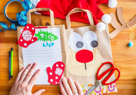 two handmade christmas crafts on recycled paper bags. ecological christmas. christmas concept