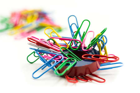 Magnet and paper clips isolated on a white background