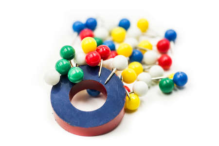 round red and blue magnet attracting metal paper pins