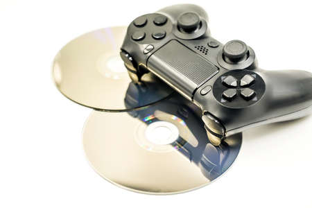 black game controller and cds isolated on white Stock Photo