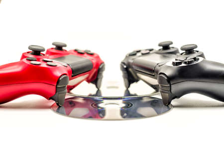 red and black game pads with cds isolated on background