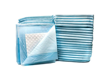 piles of toilet pads for pets isolated on white. home leak proog training pads for animals Stock Photo - 96237560