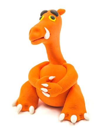 orange hand made modeling clay dragon isolated on white
