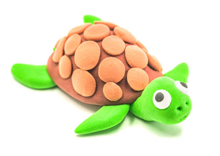 Plasticine cute green turtle isolated on a white background 写真素材
