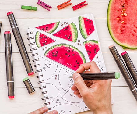 drawing a bright watermelon sketch with markers on wooden background Stock Photo