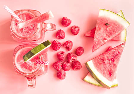 summer drinks concept. watermelon slices and smoothies in mason jar on pink background top view. Stock fotó