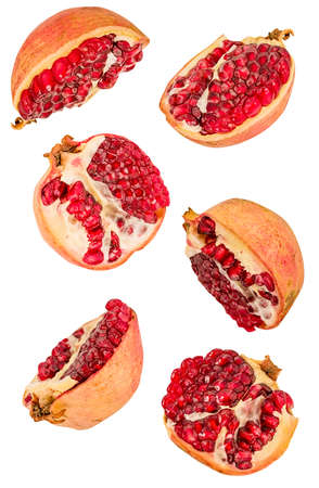 pomegranate halves flying isolated on white background w Imagens
