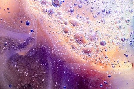 Abstract background or texture with oil bubbles motion on water surface