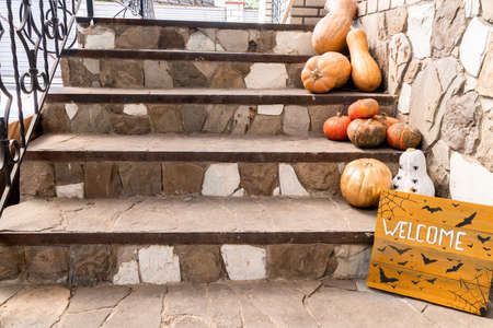 Halloween concept. Halloween pumpkins and decorations on doorsteps