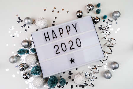 white letter lightbox with Happy 2020 surrouded with christmas decorations Stockfoto