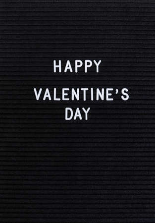 Valentines Day concept. The words Happy Valentine's Day on the black felt letter board