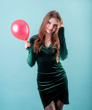 woman holding a heart shaped balloon for Valentines Day