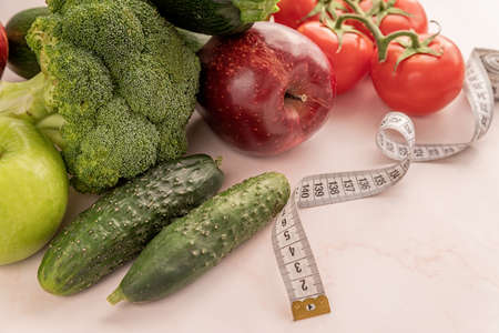 Healthy diet. Fresh vegetables and fruit for healthy diet and a measuring tape