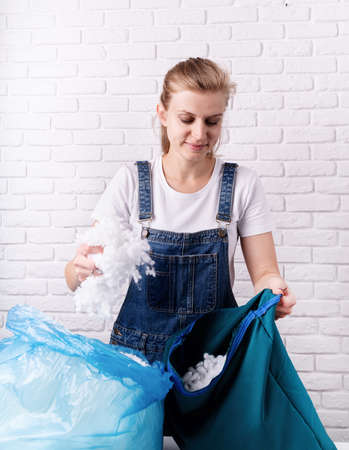 Woman tailor stuffing a pillow in her studio Reklamní fotografie
