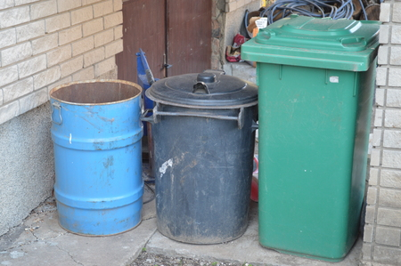 wheelie: Image of wheelie bins lined up for refuse collection