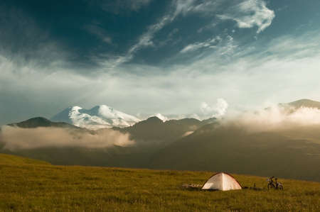 Camp in mountains during bicycle travel photo