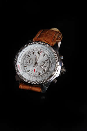 wrist strap: wristwatch shot in Studio on black backgrownd