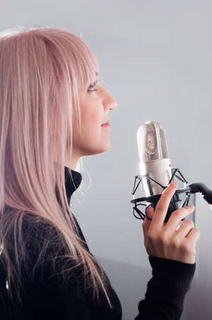 portrait of blonde girl at the microphone Stock Photo - 9851895