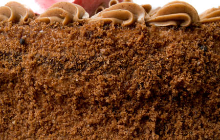 Chocolate cake texture. Holiday background. Close-up. photo