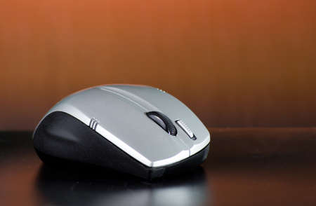 wireless mouse on brown background photo
