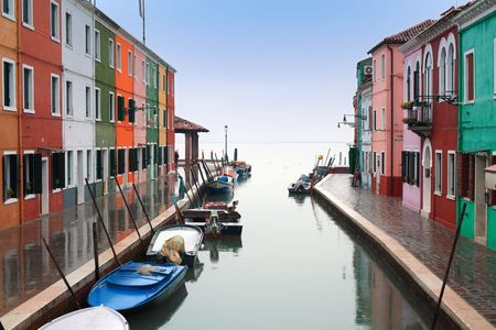 The bright pastel-coloured houses on Burano Island in the north of Venices lagoon, Italy Stock Photo