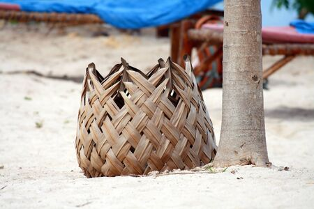 An unusual bin made of palm leaves
