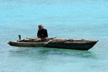 A fisherman on a quiet sunny day