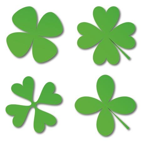 Quattro cloverleafs verdi su uno sfondo bianco Archivio Fotografico - 13225546