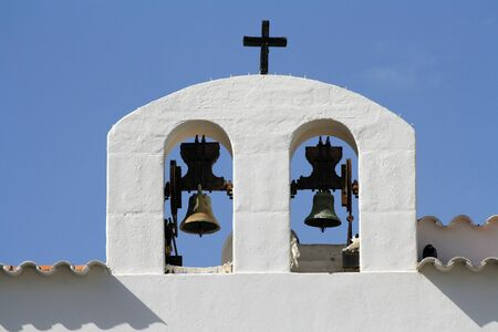 Two bells of a white church in Ibiza, Spain