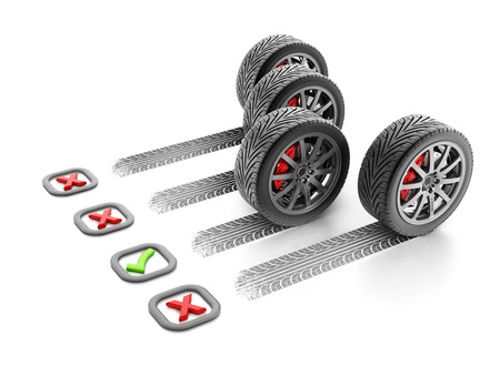 braking distance: Checkmark next to the best tire with short braking distance Stock Photo