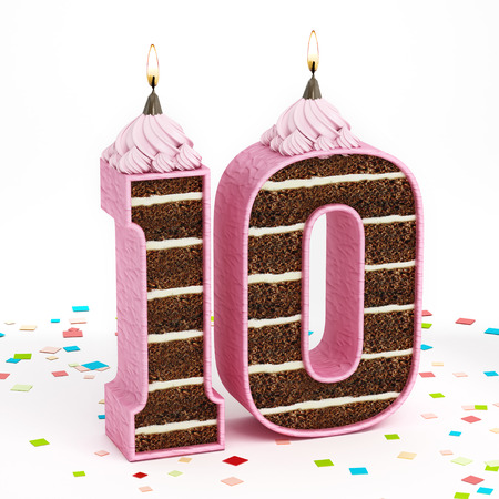Number 10 shaped chocolate birthday cake with lit candle.