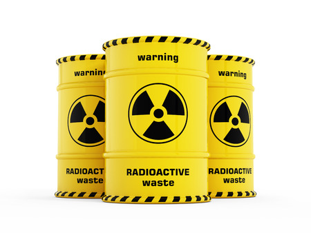Yellow radioactive barrels stack with warning signs. Stock Photo