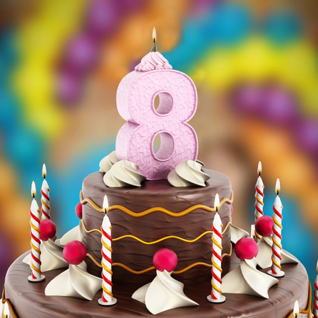 8 years birthday: Birthday cake with number 8 lit candle. Stock Photo