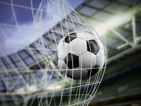 goal kick: Football at the back of the net Stock Photo