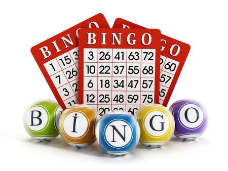 Bingo balls and cards isolated on white background. Stock Photo