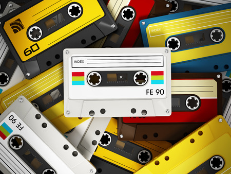 Spotlit retro audio cassettes stack photo