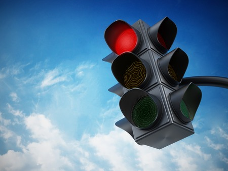 light red: Green traffic light against blue sky. Stock Photo