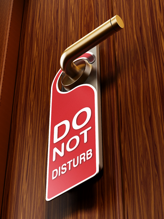 hotel room door: Do not disturb sign on the hotel room door
