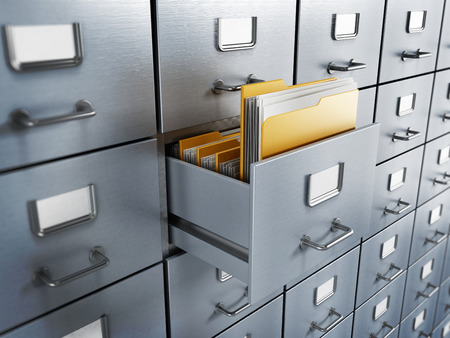Filing cabinet with a single yellow folder in an open drawer Stock Photo - 37462474
