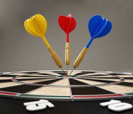 hardship: Darts hit right at the center of the target Stock Photo