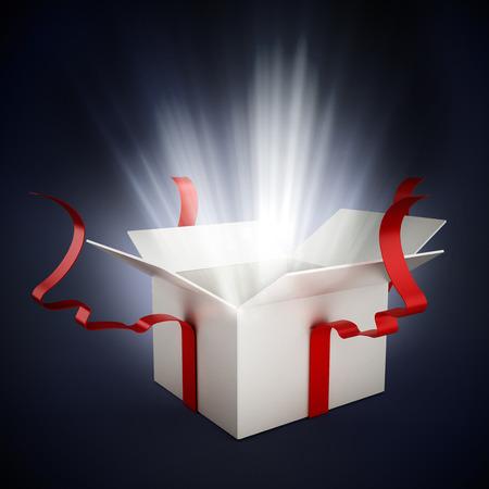 Offene Geschenkbox mit einem weißen Schein auf dunklem Hintergrund Standard-Bild
